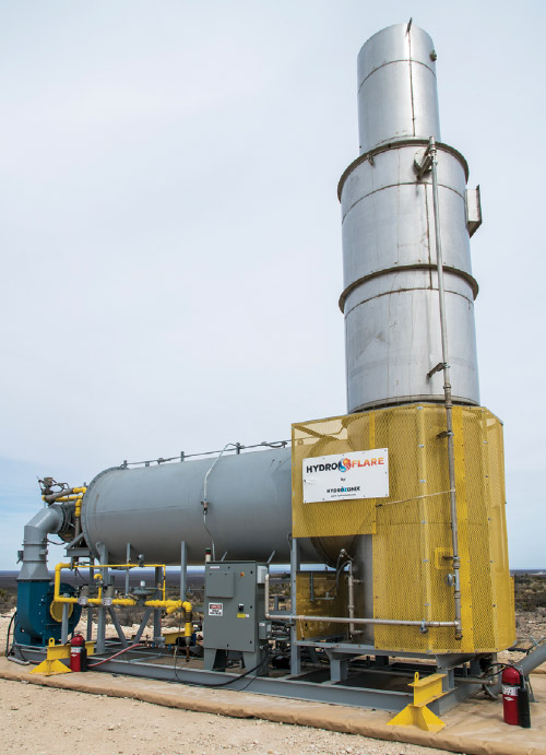 Enclosed flare that uses produced water to scrub emissions