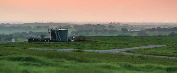 Tanks on grassy land