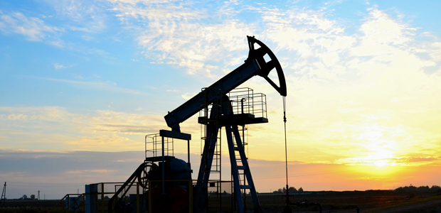 pumpjack with sunrise background
