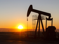 pumpjack in front of sunset