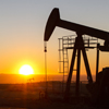 pumpjack with sunset in the background