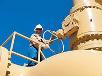 man holding steering wheel on top of pipeline